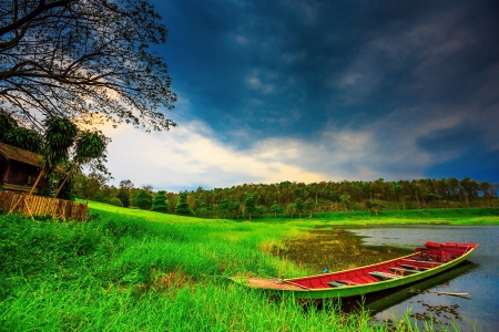 Green fishing boat in the lake, Thailand  photo