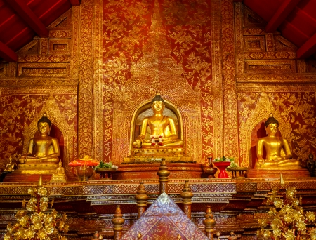 Golden Buddha statue in front of the temple