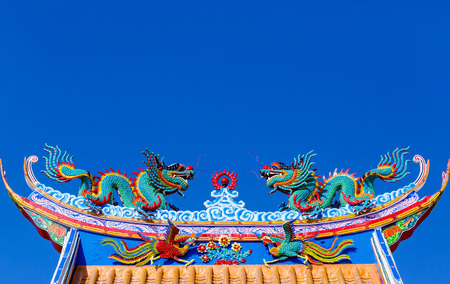 dragon statue on china temple roof photo