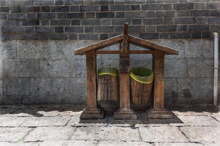 segregate: Exotic trash can garbage bin on walkway in Lijiang, China