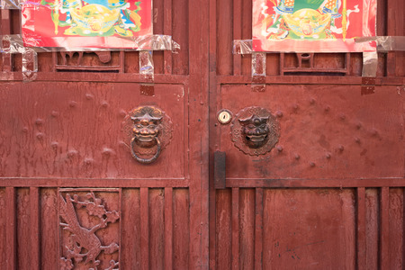 primordial: Ancient Chinese knocker. Located in Old Town of Lijiang, Yunnan province, China. Stock Photo
