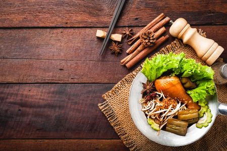 Chicken noodle with spice, herb and chopsticks on wood background Stock Photo