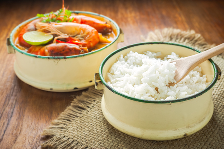 Thai food, River prawn spicy soup or tom yum goong on wooden table Stock Photo