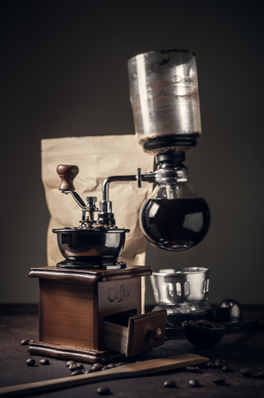 Japanese siphon coffee maker on old kitchen table