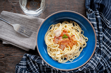 Tradition Italian food pasta carbonara, Spaghetti with bacon, ham and parmesan cheese on wooden table. Stock fotó