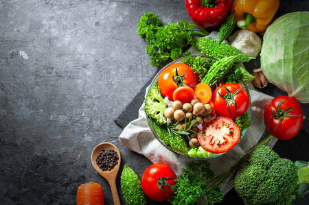 Various fresh vegetables organic food for healthy on dark rustic background with copy space for your text.
