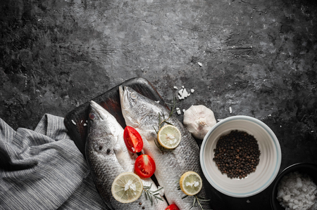Fresh raw sea bass fish on wooden cutting board, cooking concept. Stock fotó