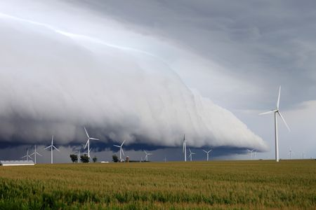 Wind turbines under an ominous shelf cloud in northern Illinois. photo