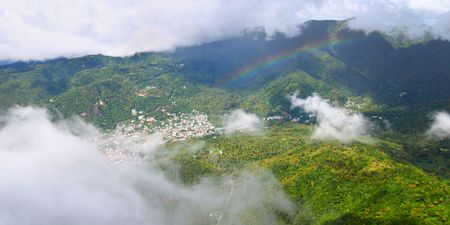 petit: View of Soufriere from the cloud covered summit of the Petit Piton - St Lucia. Stock Photo