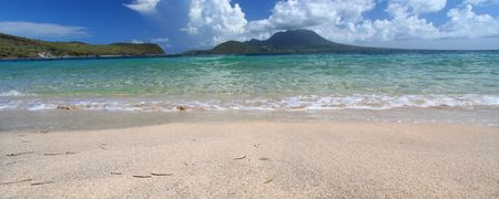 Waves wash ashore at Majors Bay Beach on the Caribbean island of Saint Kitts photo