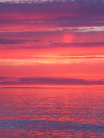 Beautiful pink colors reflect off Lake Superior in northern Michigan.
