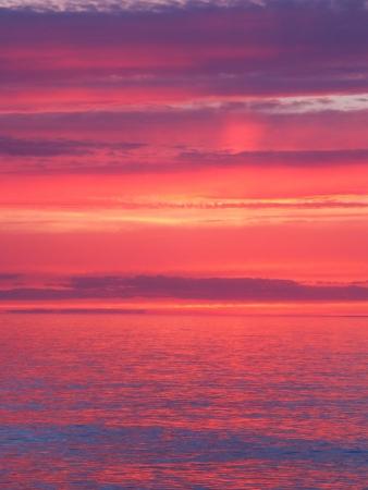 lake michigan: Beautiful pink colors reflect off Lake Superior in northern Michigan.