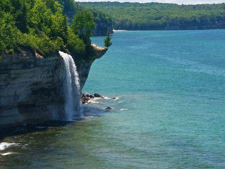 peninsula: Spray Falls plunges into Lake Superior at Pictured Rocks National Lakeshore, Michigan Stock Photo