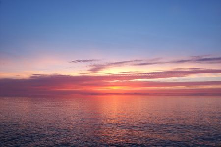 Beautiful pink colors reflect off Lake Superior in northern Michigan. Stock Photo - 7926750