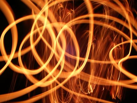 Bright swirls of flame light up the night. Stock Photo - 7998595