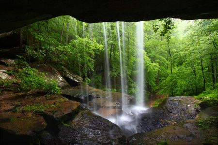 View from behind a tranquil waterfall on Cane Creek in northern Alabama Stock Photo