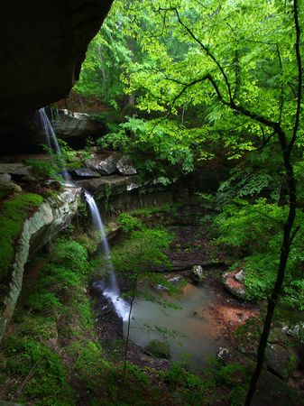 Waterfall flows into a deep canyon in the woodland of northern Alabama Stock Photo - 8094307