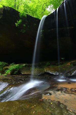 Waterfall flows into a deep canyon in the woodland of northern Alabama Stock Photo - 8153443