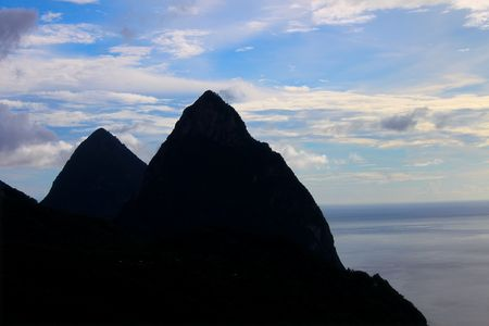 Famous Pitons of Saint Lucia silhouetted against the sky photo