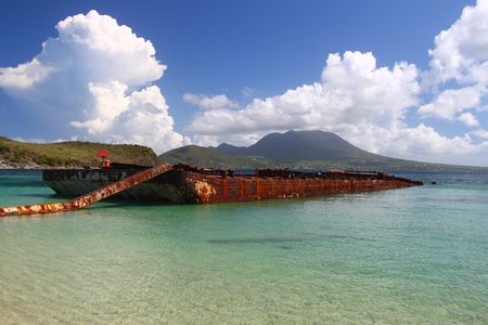 majors: Wrecked barge serves as a makeshift fishing pier in Majors Bay - St Kitts Stock Photo