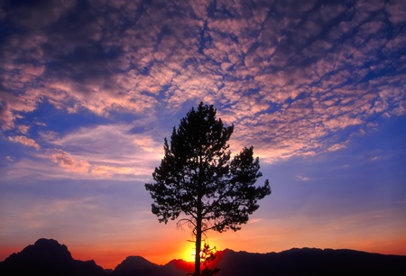 Magnificent sunset over the Grand Tetons in northwest Wyoming photo