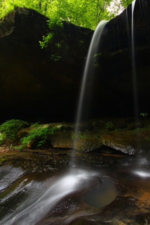 cane creek: Waterfall flows smoothly into a canyon of northern Alabama