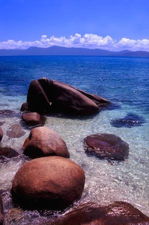 Light waves wash in among huge boulders on Nudey Beach of Fitzroy Island, Australia Stock Photo - 8779146