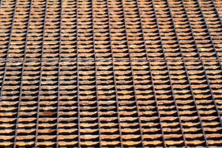 grate: Background of a rusty steel grate