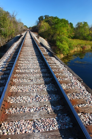 forest railroad: Railroad tracks go on for miles in northern Illinois Stock Photo