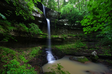 Waterfall flows into a deep canyon in the woodland of northern Alabama Stock Photo - 9557032