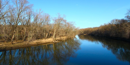 reflect: Trees reflect off the Kishwaukee river in northern Illinois. Stock Photo