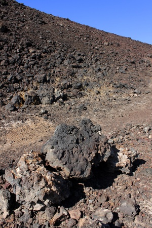 natural landmark: Volcanic rock scatters the desert around Amboy Crater National Natural Landmark in California Stock Photo