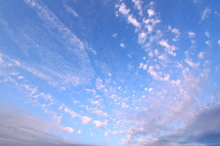 forcast: Puffy clouds form a mosaic against the blue sky