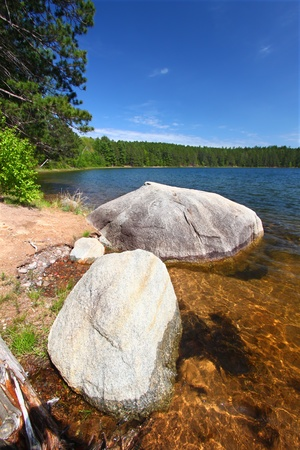 legion: Huge boulder along the shoreline of Buffalo Lake in the Northern Highland-American Legion State Forest of Wisconsin Stock Photo