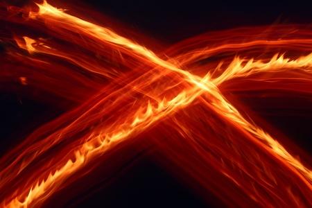 Vivid streaks of flame against a dark night photo