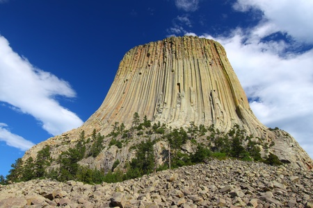 Devils Tower National Monument rises prominently from the landscape of northeastern Wyoming Stock Photo