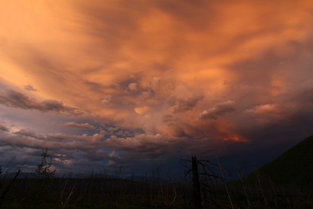 Clouds at twilight create an eerie palette of color in the skies above Glacier National Park Stock Photo - 11568198