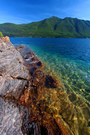 hydrology: Beautiful glacial rocks of Lake McDonald in Glacier National Park - Montana