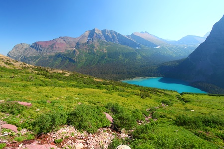 Turquoise waters of Grinnell Lake amidst the majestic alpine scenery of Glacier National Park photo