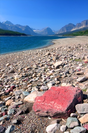 Rocky shoreline of Lake Sherburne in Glacier National Park of Montana