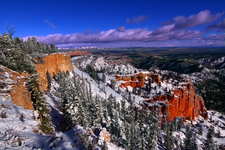 Beautiful snow covered cliffs of Bryce Canyon National Park of Utah photo