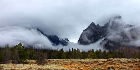 Clouds hang over jagged peaks of the Teton Range in western Wyoming