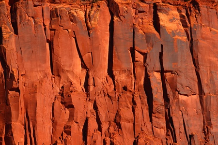 Bright red rock cliff in the rugged backcountry of Utah photo