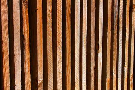 Background of bright wood fence under sunlight photo