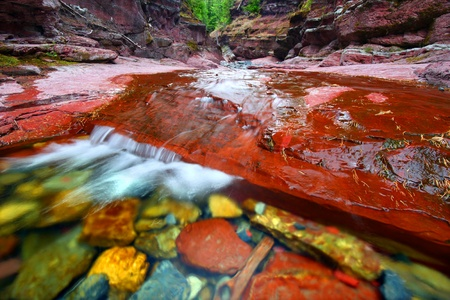 Small cascade at the bottom of Red Rock Canyon in Waterton Lakes National Park - Canada Stock Photo
