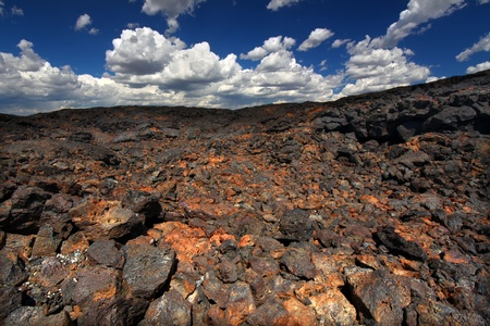 volcanic rock: Volcanic rock stretches into the landscape at Craters of the Moon National Monument of Idaho Stock Photo