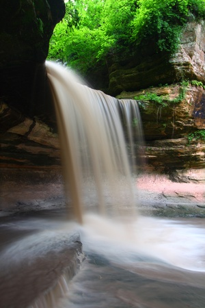 Spring rains create a beautiful scene at Lasalle Falls of Starved Rock State Park in central Illinois photo