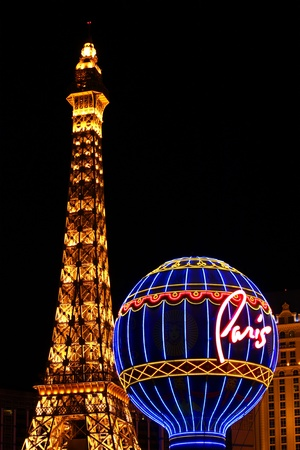 Las Vegas, USA - November 30, 2011: The Paris Las Vegas is a hotel and casino in Nevada. Seen here are the venues replicas of the Eiffel Tower and the Montgolfier Balloon adorned in bright lights.