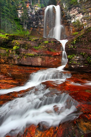 Beautiful Virginia Falls in the forests of Glacier National Park in northern Montana photo