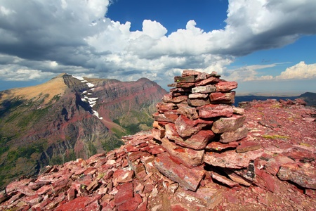 Rock cairn marking the summit of Mount Sinopah in Glacier National Park of Montana